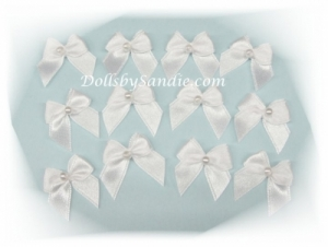 Decorate with Package of 12 White Itty Bitty Bows with Pearl